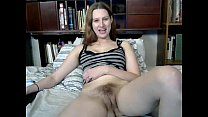 Screenshot Busty cutie  toys her hairy pussy on webcam