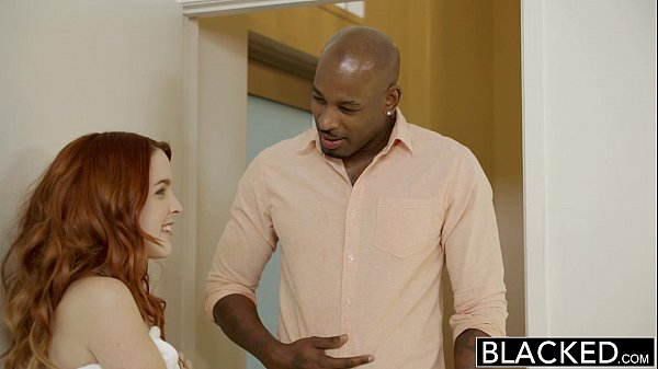 Cute redhead engages into sexual activity with a black dude